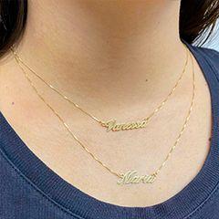 Compre sua gargantilha de ouro com letra na mave